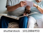 senior couple looking at family ... | Shutterstock . vector #1012886953