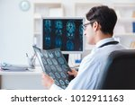 doctor radiologist looking at x ...   Shutterstock . vector #1012911163