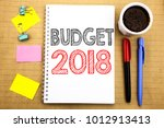 Small photo of Word, writing Budget 2018. Business concept for Household budgeting accounting planning Written on notepad note paper background with space office view with pencil marker coffee