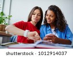smiling girl showing her dark...   Shutterstock . vector #1012914037