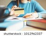 unrecognizable woman using... | Shutterstock . vector #1012962337