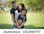 group of young family picnic... | Shutterstock . vector #1012965757