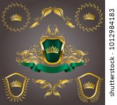 set of golden royal shields... | Shutterstock .eps vector #1012984183
