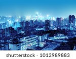 high rise mountain city night ... | Shutterstock . vector #1012989883