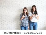 couple of young attractive... | Shutterstock . vector #1013017273