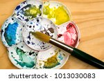 artists flower shaped style... | Shutterstock . vector #1013030083
