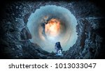 space hole and astronaut. mixed ... | Shutterstock . vector #1013033047