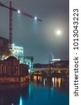 Small photo of spree river with industrial crane and bode museum at night