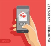 sending love message concept.... | Shutterstock .eps vector #1013047687