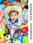 thai boy 7 months old is... | Shutterstock . vector #1013054233