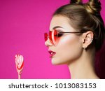 young beautiful playful woman... | Shutterstock . vector #1013083153