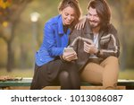 cute couple making selfie on a... | Shutterstock . vector #1013086087