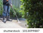 the man cleaning with high... | Shutterstock . vector #1013099887