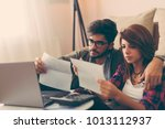 young couple managing their... | Shutterstock . vector #1013112937