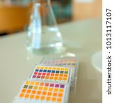 Small photo of A table with different colours. Pupils are doing an experiment in a Chemistry class and they will see what a specific result means when checking the meaning of a particular colour in this table.