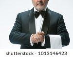 The Senior Waiter Holding Whit...