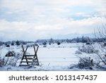 wooden stile in a wintry...   Shutterstock . vector #1013147437
