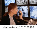 female security guard using... | Shutterstock . vector #1013155933