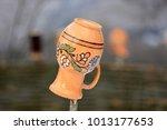 ukrainian clay jug on a wooden... | Shutterstock . vector #1013177653