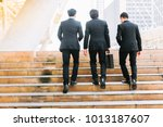 businessmen confidently walk to ... | Shutterstock . vector #1013187607