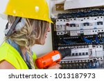 electrician at work with an... | Shutterstock . vector #1013187973