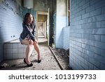Model Sitting In An Abandoned...