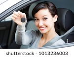 happy female driver showing car ...   Shutterstock . vector #1013236003