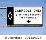 Overhead freeway carpool only sign with blue sky. - stock photo