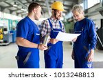 engineer teaching apprentices... | Shutterstock . vector #1013248813