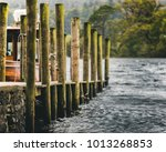 A Wooden And Stone Dock Off Of...