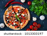 homemade pizza with tomatoes ...   Shutterstock . vector #1013303197