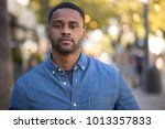 young man in city serious face... | Shutterstock . vector #1013357833