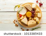 cheese on wooden table | Shutterstock . vector #1013385433