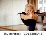 a woman tries to perform a... | Shutterstock . vector #1013388043