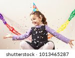 little girl with confetti | Shutterstock . vector #1013465287