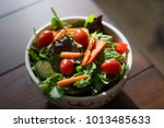 a colorful salad in sunshine | Shutterstock . vector #1013485633