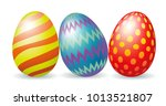 three colorful easter eggs... | Shutterstock . vector #1013521807
