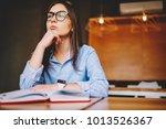 pensive young woman in eyewear... | Shutterstock . vector #1013526367