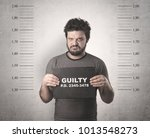 caught guilty man with id signs ... | Shutterstock . vector #1013548273