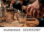 waiter pours alcoholic...   Shutterstock . vector #1013552587