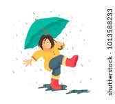 kid walking under the rain with ... | Shutterstock .eps vector #1013588233