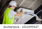 air conditioning technician and ... | Shutterstock . vector #1013599327