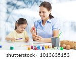 mother and her daughter drowing | Shutterstock . vector #1013635153