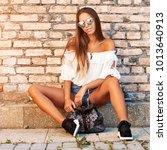 street portrait of stylish girl ...   Shutterstock . vector #1013640913