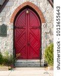 arched exterior red door and... | Shutterstock . vector #1013655643