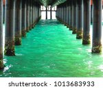 peering beneath the pier  belek ... | Shutterstock . vector #1013683933