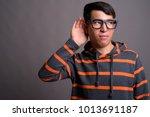 studio shot of young asian nerd ...   Shutterstock . vector #1013691187