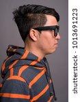 studio shot of young asian nerd ...   Shutterstock . vector #1013691223