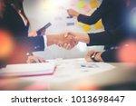 business people shaking hands... | Shutterstock . vector #1013698447