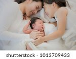 happy loving family. pretty... | Shutterstock . vector #1013709433